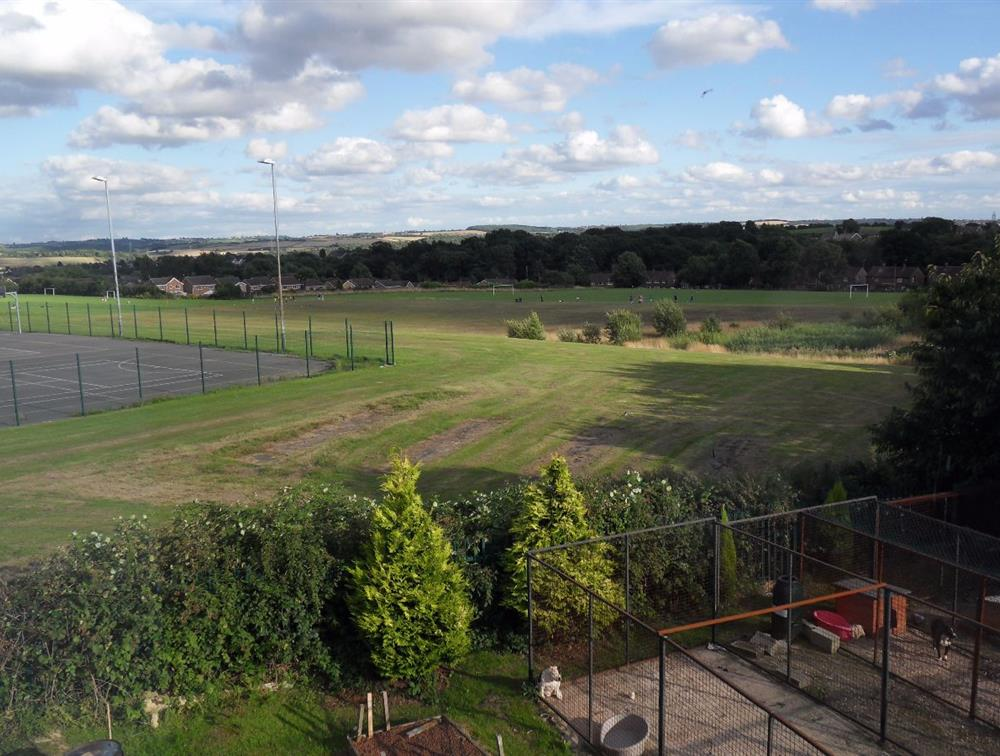 View from the upstairs window looking onto a field and park